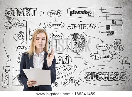 Businesswoman With Papers And Startup On Concrete