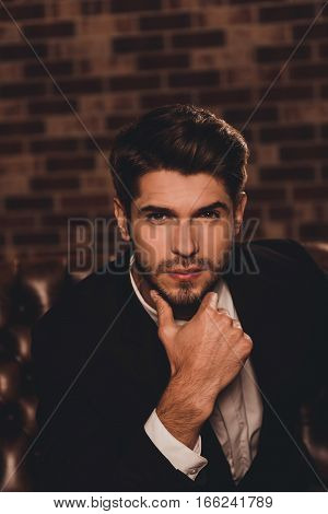 Portrait Of Young Handsome Sexy Minded Man Touching Chin