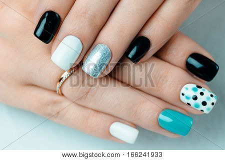 Female hand with trendy manicure. Nail design on a white background closeup