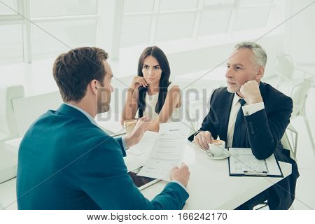 Business People In Formal Wear Having Meeting And Discussing New Contract