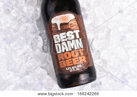 IRVINE CALIFORNIA - JANUARY 22 2017: Best Damn Root Beer bottle on ice. The Hard Root Beer contains 5.5% alcohol. They also brew Hard Apple Ale and Cherry Cola.