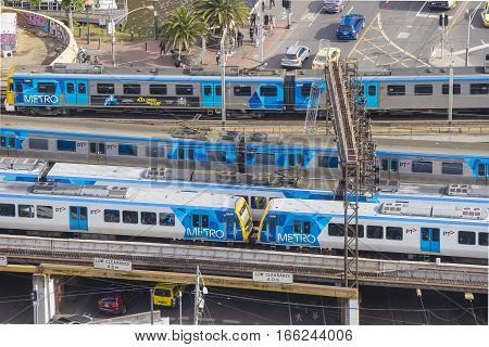 Melbourne, Australia - Nov 28, 2016: Metro trains departing and arriving at a railway station.