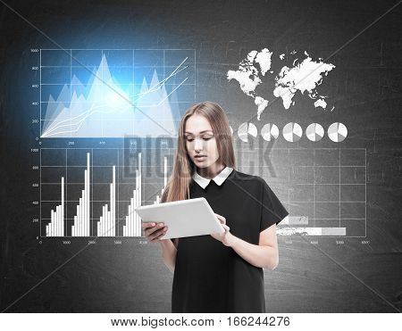 Woman With Tablet And Four Graphs On Blackboard