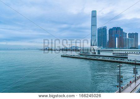 Hong Kong victoria harbor skyline and ferry pierchina.