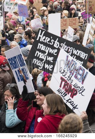 PHILADELPHIA, PA - JAN 21 2017: Women's March on Philadelphia. A sister march of Women's March on Washington. Women and men gathering in peaceful protest on Benjamin Franklin Parkway. Dense crowd shot