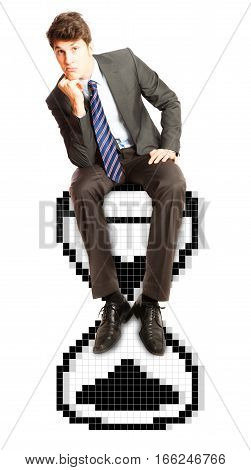 young man in business suit is sitting on an hourglass icon