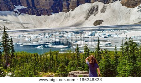 Hiker Viewing Icebergs in Alpine Lake View