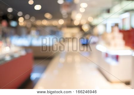 Blurred shopping mall in modern city in Asia