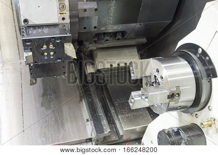 CNC lath machine (CNC Turning machine) while cutting roughing process with the raw material rod