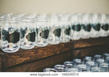 Rustic empty wedding glasses with a chulk label
