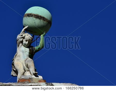 Little Atlas old statue holding up the globe in Venice (with copy space)
