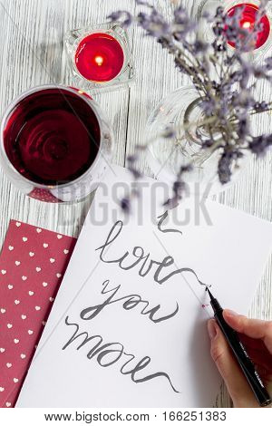 concept of Valentine's Day love letter on wooden background top view.
