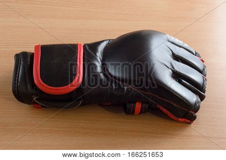 black mma gloves on a wooden background