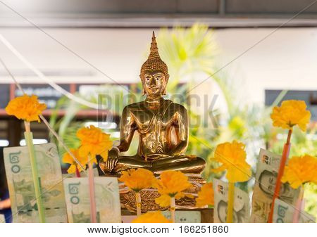 public golden buddha in public temple on Thai new year day