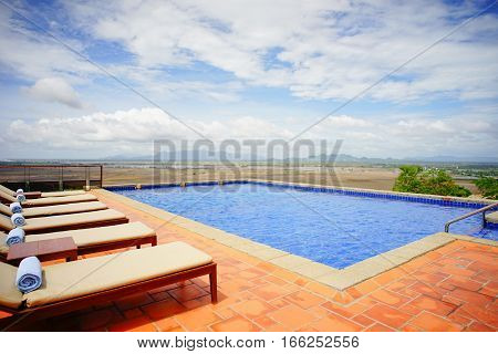 Relaxing Chairs At Beautiful Swimming Pool