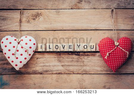 Heart Fabric And Wooden Text I Love You On Wooden Table Background.