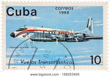 MOSCOW RUSSIA - January 17 2017: A stamp printed in Cuba shows passenger airliner Douglas DC-7 Flight Havana-Luanda (1975) series