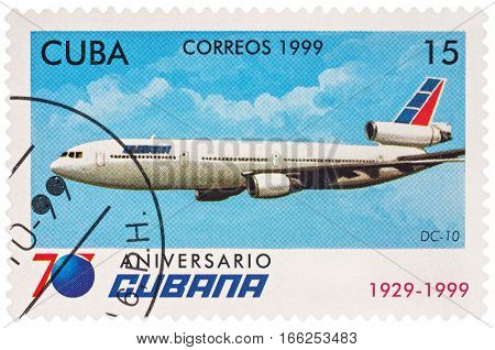 MOSCOW RUSSIA - January 17 2017: A stamp printed in Cuba shows passenger aircraft Douglas DC-10 series