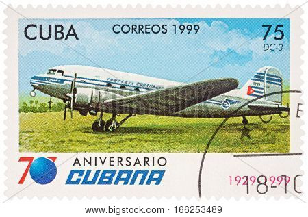 MOSCOW RUSSIA - January 17 2017: A stamp printed in Cuba shows passenger aircraft Douglas DC-3 series