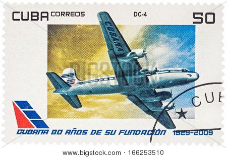 MOSCOW RUSSIA - January 18 2017: A stamp printed in Cuba shows passenger aircraft Douglas DC-4 series