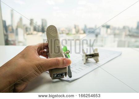 businesswoman use stapler pull staple from paper sheet