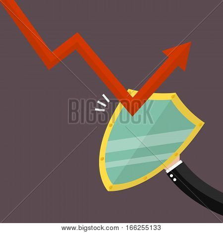 Businessman is protected by a shield from graph down