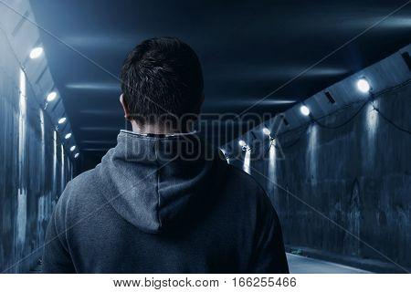 Man standing alone in the underground tunnel