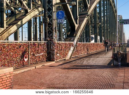 Cologne Germany - January 19 2017: Locks of love on the fence of the Hohenzollern Bridge. Hohenzollern Bridge in Cologne becomes a place of pilgrimage for young couples.