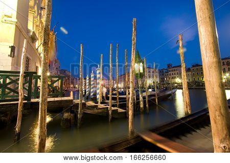 grand canal after sunset. long exposure and heavily motion-blurred gondolas in the foreground