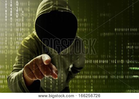 Dangerous unknown hacker searching data on computer