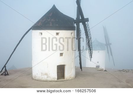 Windmills in a thick fog in Castilla-La Mancha, Spain