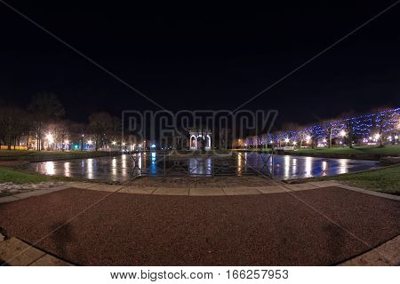The artificial lake called Swan Pond in the Kadriorg park in Tallinn Estonia is quite a place to see in the winter nights. The Christmas lights on the trees reflect their light on the still water of the lake.
