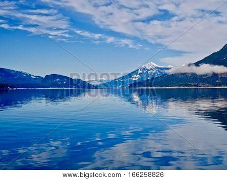 Blue lake in winter. Upper Arrow lake. Columbia River. Selkirk and Monashee Mountains. Keenleyside Dam. Castlegar. Revelstoke. British Columbia. Canada.