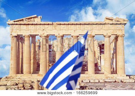 Parthenon on the Acropolis in Athens with Greece flag