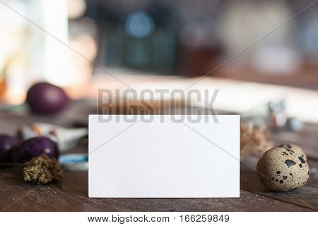 Blank card with eggs, free space for text. Empty white sheet of paper with Easter attributes. Holiday, tradition, family concept