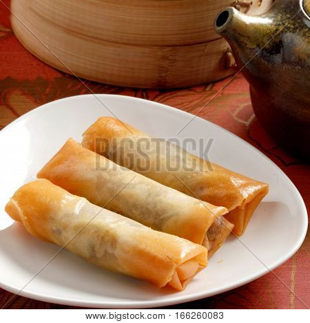 Traditional Chinese Fried Spring Rolls On White Plate