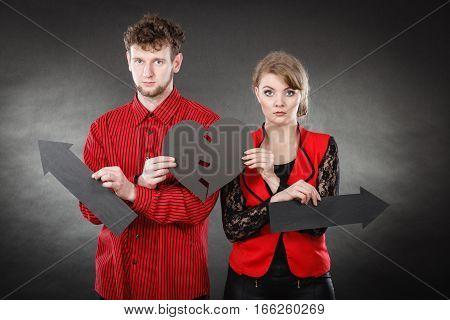 Young Pair Showing Heartbreak Symbols.