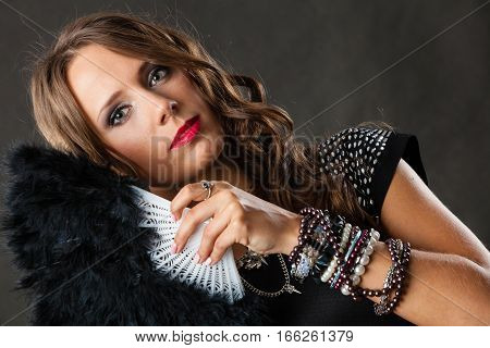 Party new year celebration and carnival concept. Portrait of beautiful brunette woman with black feather fan in hand