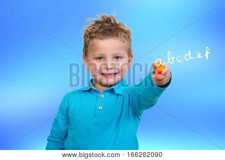 3 years old child point orange pen.