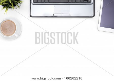 White office desk table with computer notebook tablet and coffee cup Top view with copy space