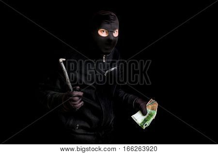Masked Thief In Balaclava With Crowbar Isolated On Black