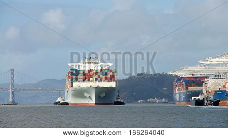 Oakland CA - January 19 2017: Cargo ship COSCO DEVELOPMENT entering the Port of Oakland the fifth busiest port in the United States.