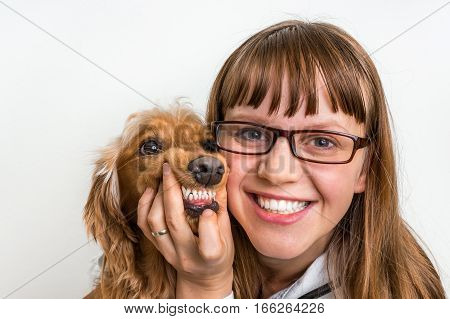 Funny Smiling Dog And Veterinarian In Veterinary Clinic