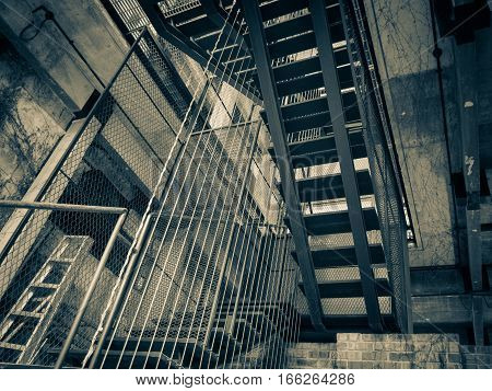 vintage color of staircase with brick wall texture background