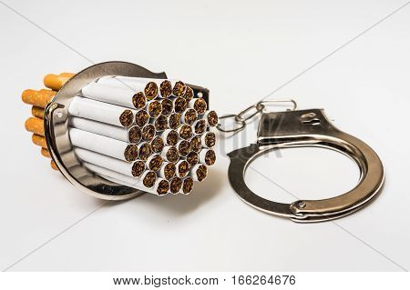 Cigarettes And Handcuffs - Smoking Addiction Concept