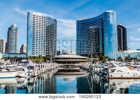 SAN DIEGO, CALIFORNIA - JANUARY 8, 2017:  Boats moored at Embarcadero Marina Park North with surrounding hotels and city skyline.