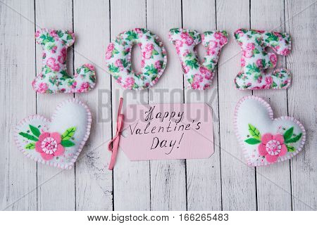 decor with a card for Valentine's day with hearts