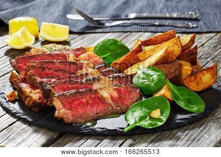 Grilled Medium-rare Marbled Ribeye Steak Cut In Slices