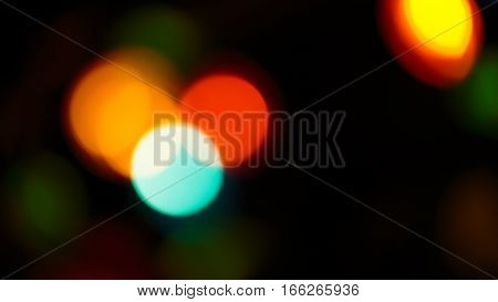 Multicolored soft bokeh on a abstract black background