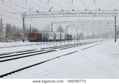 View on a snowy railroad tracks on winter